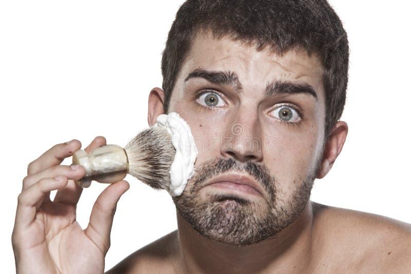 Young Man Shaving Royalty Free Stock Image