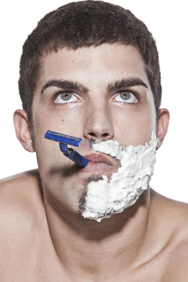 Download Young man shaving stock photo. Image of indoors, person - 10856196
