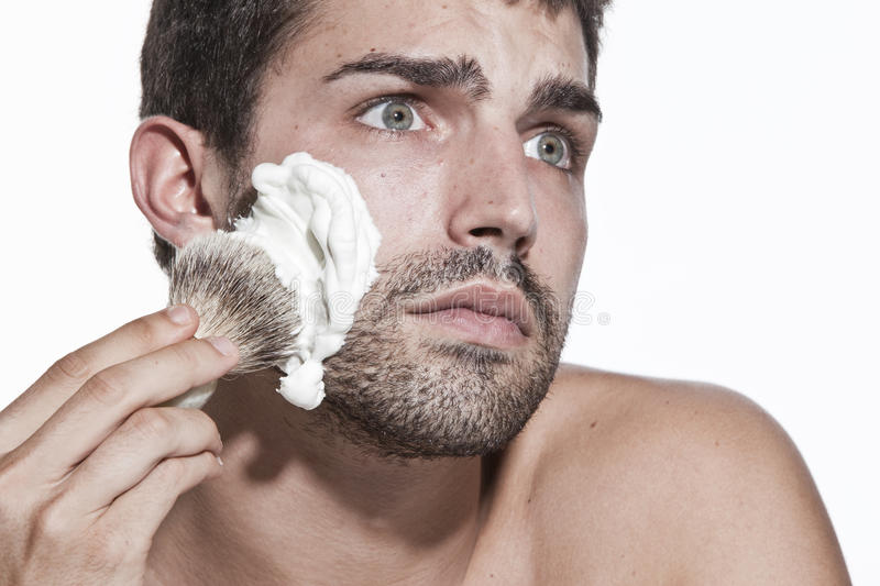 Download Young Man Shaving Royalty Free Stock Photo - Image: 10871185