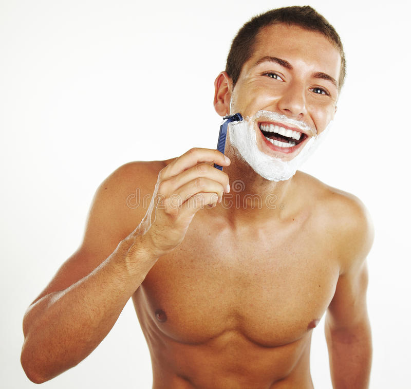 Young man shaving in the bath royalty free stock photos
