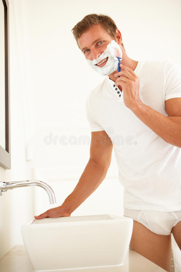 Download Young Man Shaving In Bathroom Mirror Stock Photo - Image: 14919110
