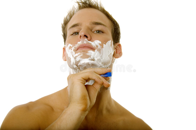 Young Man Shaving His Beard Stock Images