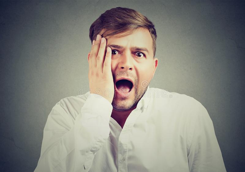 Young man with shocked facial expression royalty free stock image