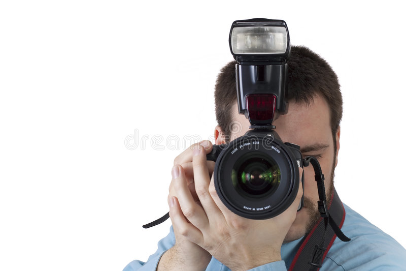 Young man shooting with digital camera stock images