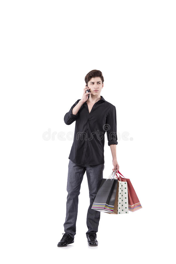 The young man in shopping concept isolated on white stock images