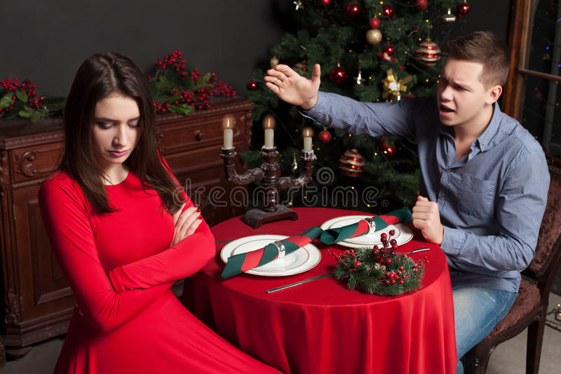 Young man shouts on dissatisfied woman stock images