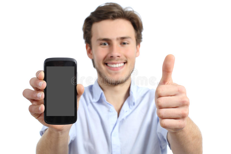 Young man showing a blank smart phone screen with thumbs up. Isolated on a white background