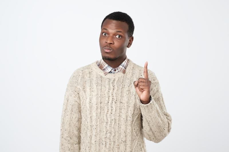 young man showing index fingers up, giving advice or recommendation royalty free stock photography
