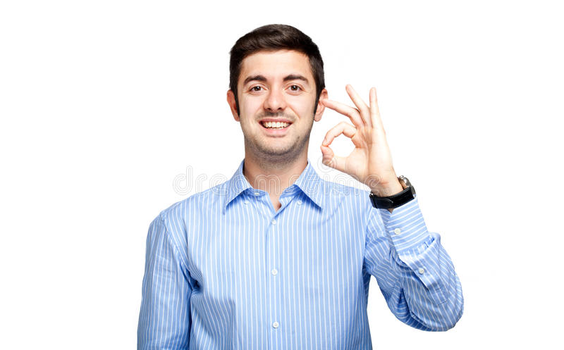 Young man showing ok sign royalty free stock photography
