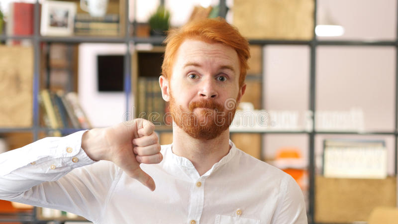 Young man showing sign of Failure, Rejection with his thumb Down stock photo