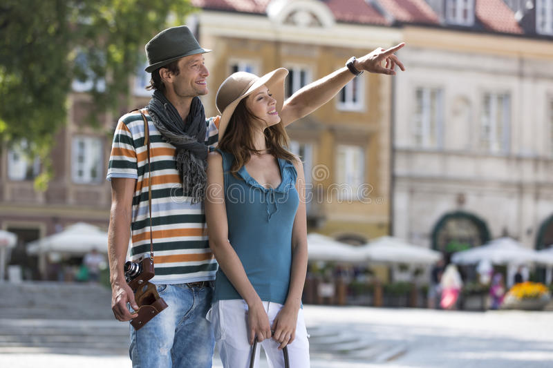 Young man showing something to woman during vacation royalty free stock photos