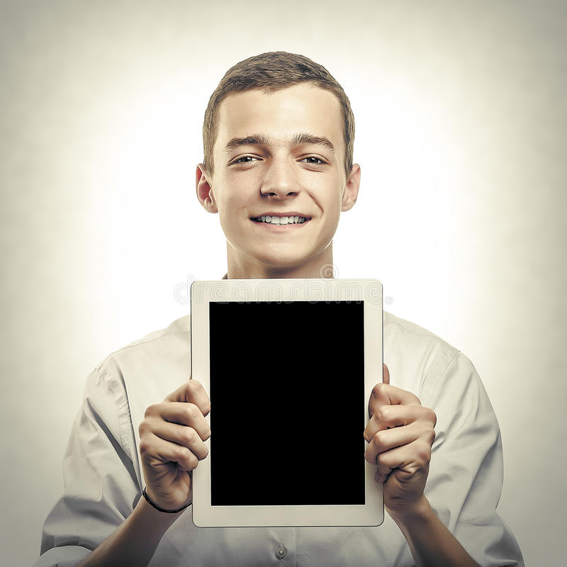 Young man showing tablet pc. stock images
