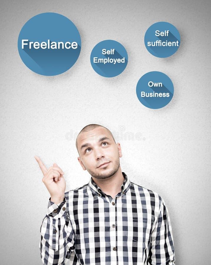Young man shows freelance work benefits stock photos