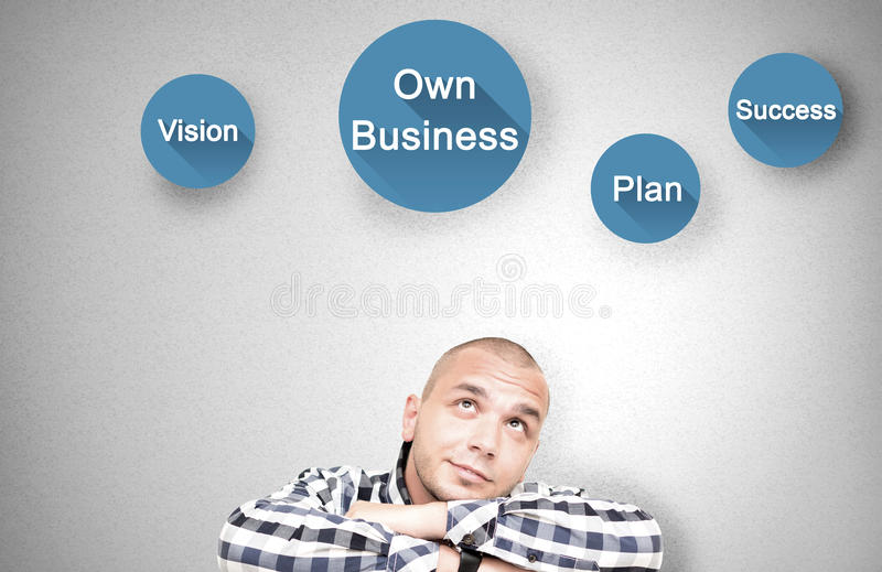 Young man shows important attributes in own business royalty free stock image