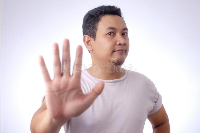 Young Man Shows Stop Gesture royalty free stock images