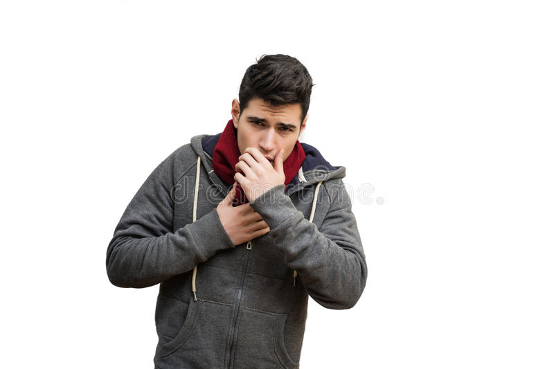 Young man sick with flu or cold, coughing stock photo