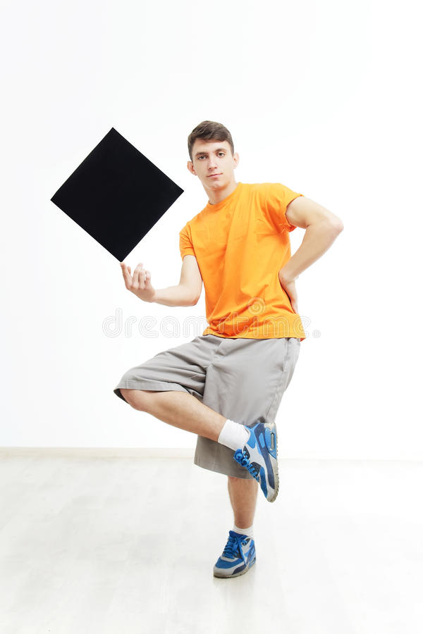Young man with sign he is holding against a white background. stock images