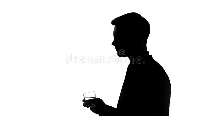 Young man silhouette drinking mineral water, pH balance in healthy body, diet royalty free stock photography