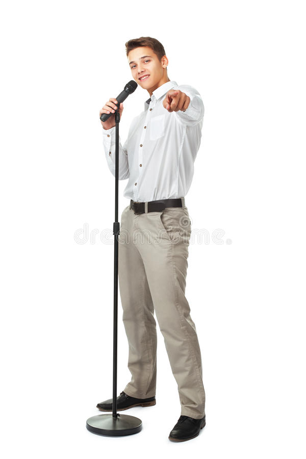 Young man singing into a microphone stock photos