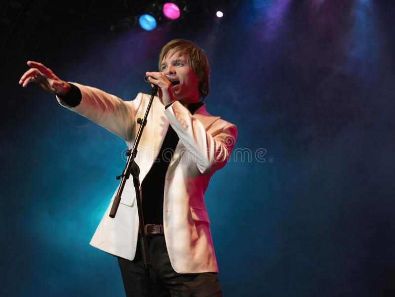Young Man Singing Into Microphone royalty free stock images
