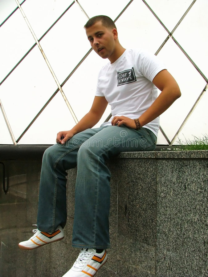 Download Young man sitting stock photo. Image of pose, look, pretty - 205390