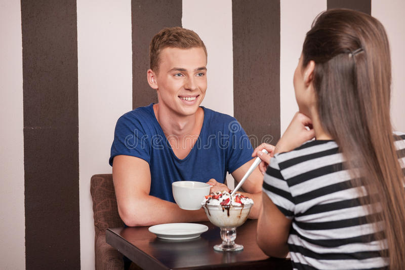 Young man sitting with beautiful girl. stock photos