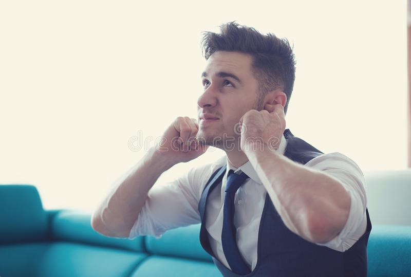Upset man suffering from upstairs noise royalty free stock photography