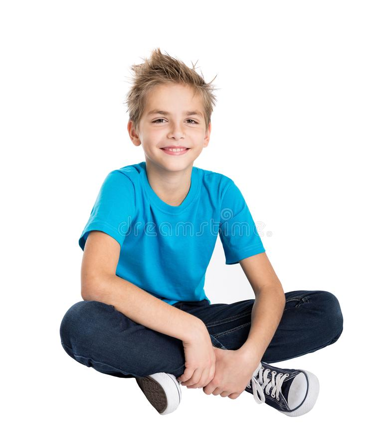 Young man sitting on the floor stock photography