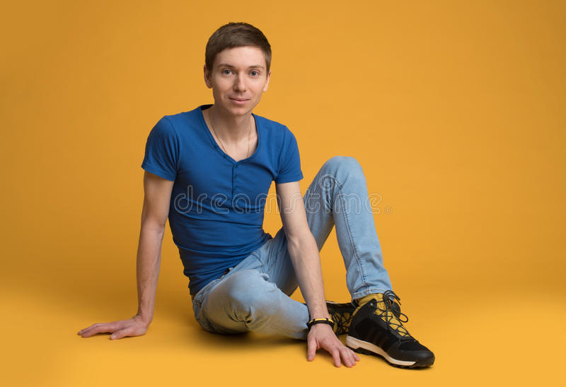 Young man sitting on the floor royalty free stock photo
