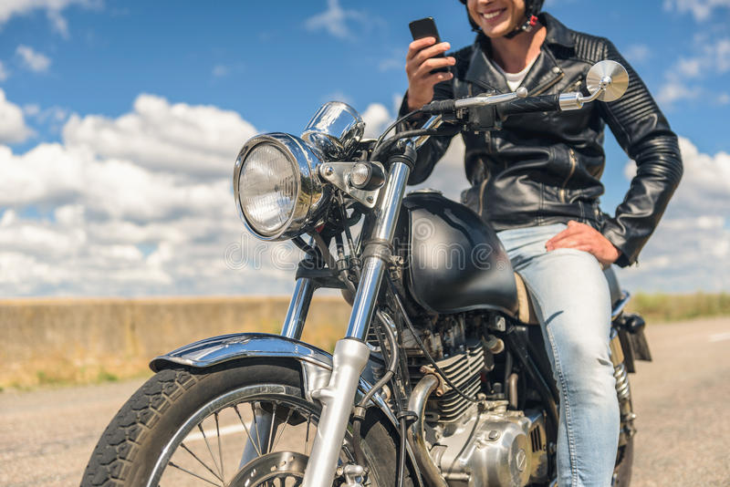 Young man sitting on his motorbike royalty free stock photos