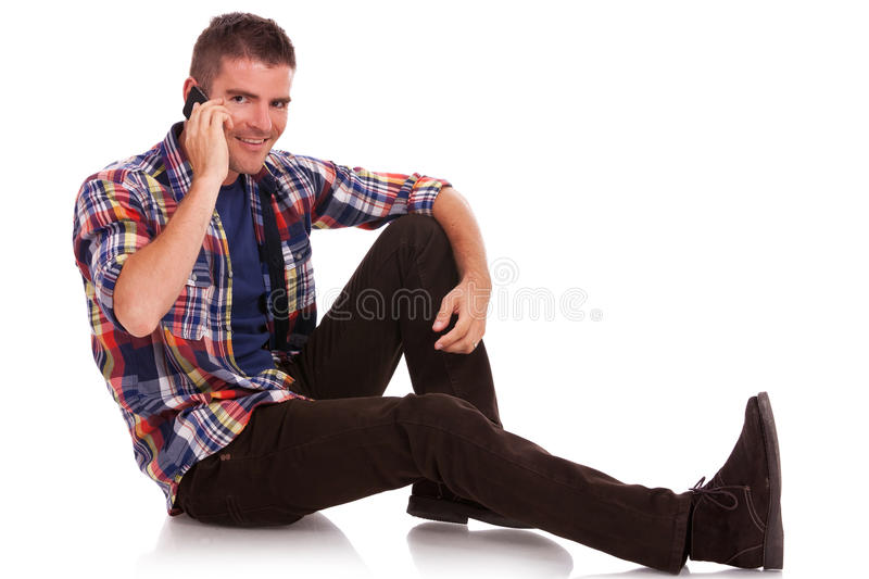 Download Young Man Sitting On The Phone Stock Image - Image of cellular, floor: 26706147