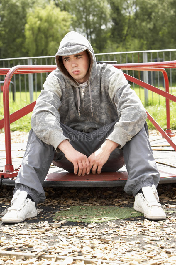 Young Man Sitting In Playground royalty free stock photo