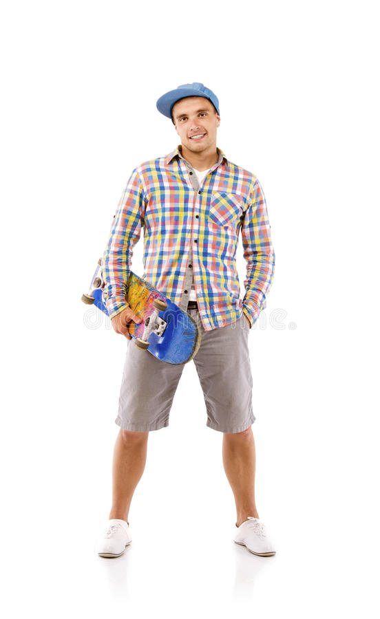 Young man with skateboard. Studio portrait of a young man with skateboard isolated over white background stock images