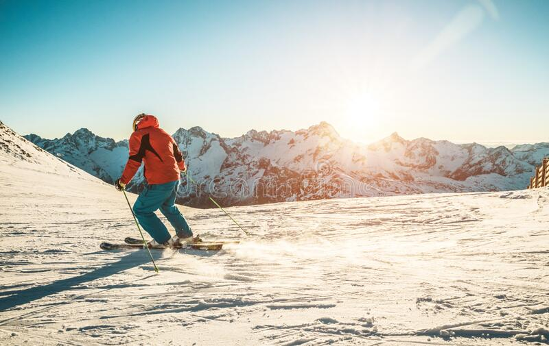 Young man skiing in alps mountains on sunny day - Skier training during winter season at sunset - Extreme sport, travel, landscape. And vacation concept - Focus royalty free stock images