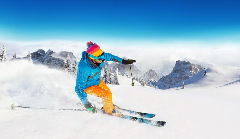 Young man skiing in Alps royalty free stock images