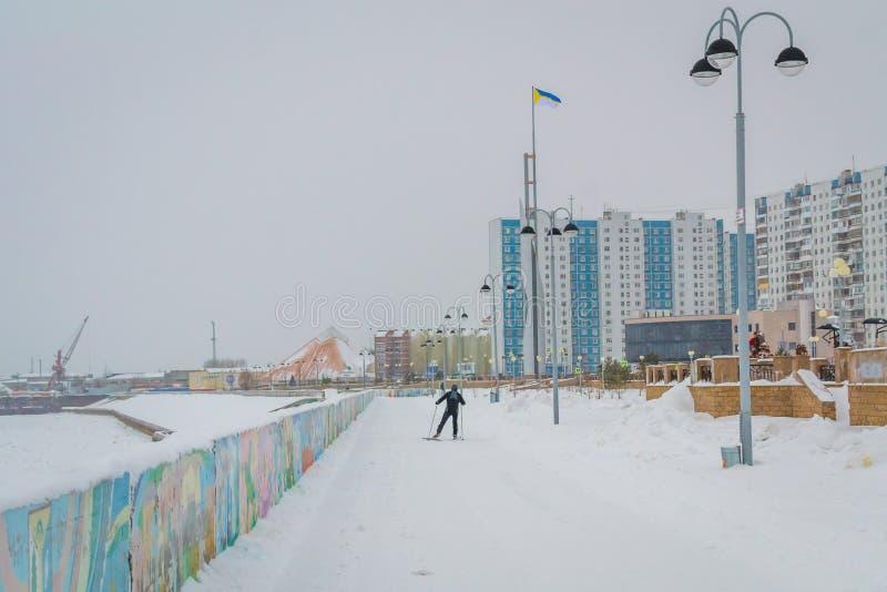 A man skis along the river stock photos