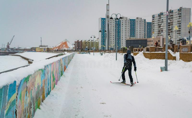 A man skis along the river stock image
