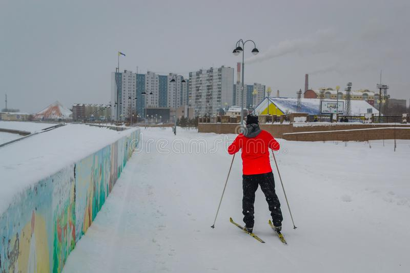 A man skis along the river royalty free stock photography