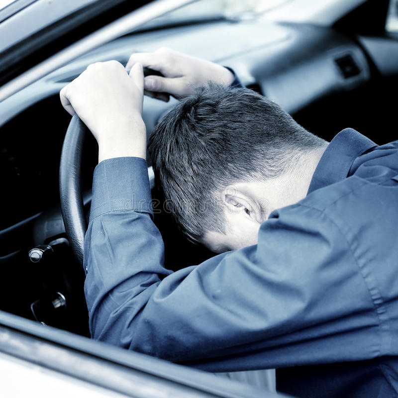 Young Man sleep in a Car stock photography