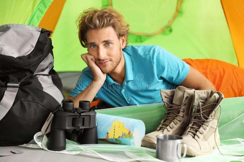 Young man in sleeping bag royalty free stock image