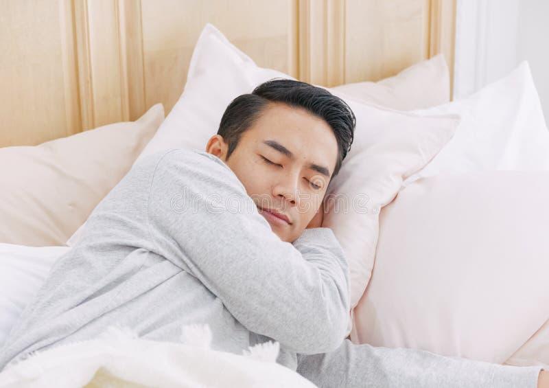 Man sleeping in bed royalty free stock photos