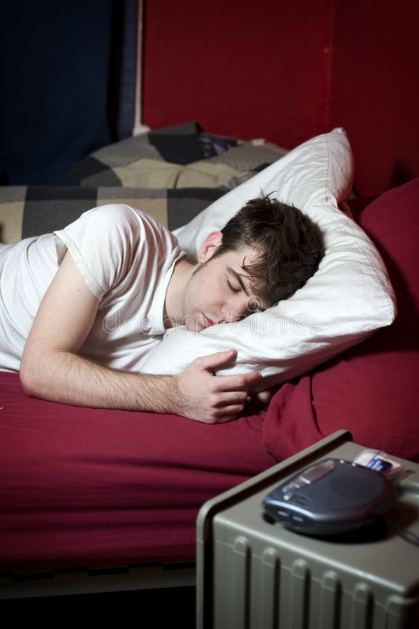 Download Young man sleeping in bed stock image. Image of dark, comfortable - 7798243