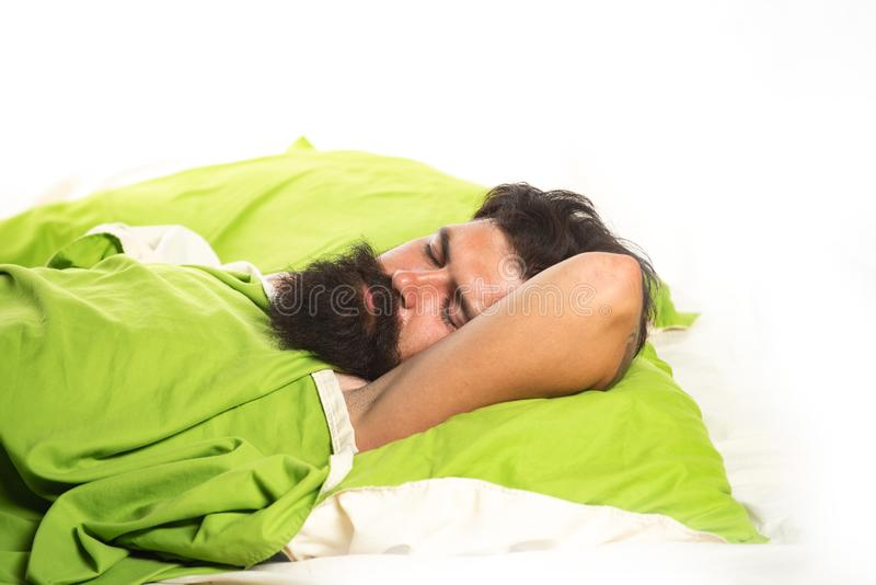 Young man sleeping on bed. Sleeping quietly calmly. Man sleeping on pillow in bed at home. Napping man concept. Young man sleeping on bed. Sleeping quietly stock photo
