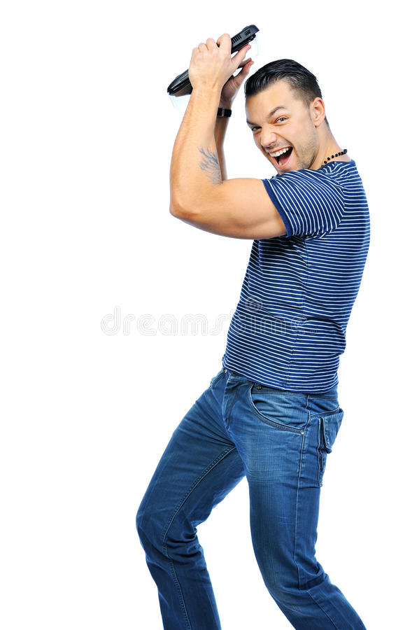 Young man smashing his laptop isolated on white royalty free stock photos