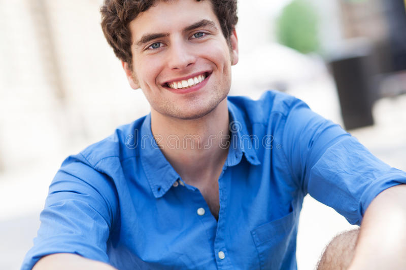 Download Young man smiling stock image. Image of toothy, outdoors - 32211743