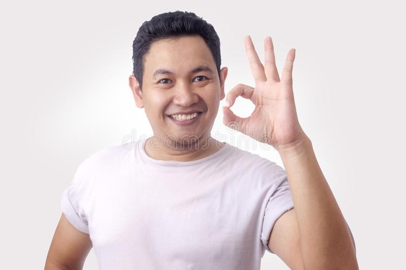 Young Man Smiling and Showing OK Sign gesture stock images