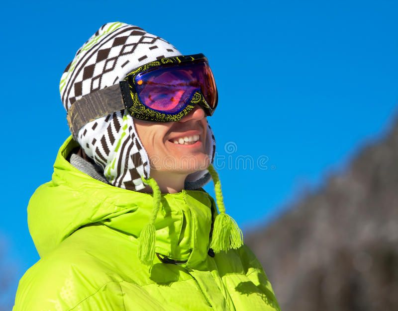 Young man smiling in ski mask stock photo