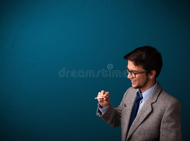 Young man smoking cigarette with copy space. Handsome young man smoking cigarette with copy space stock photography