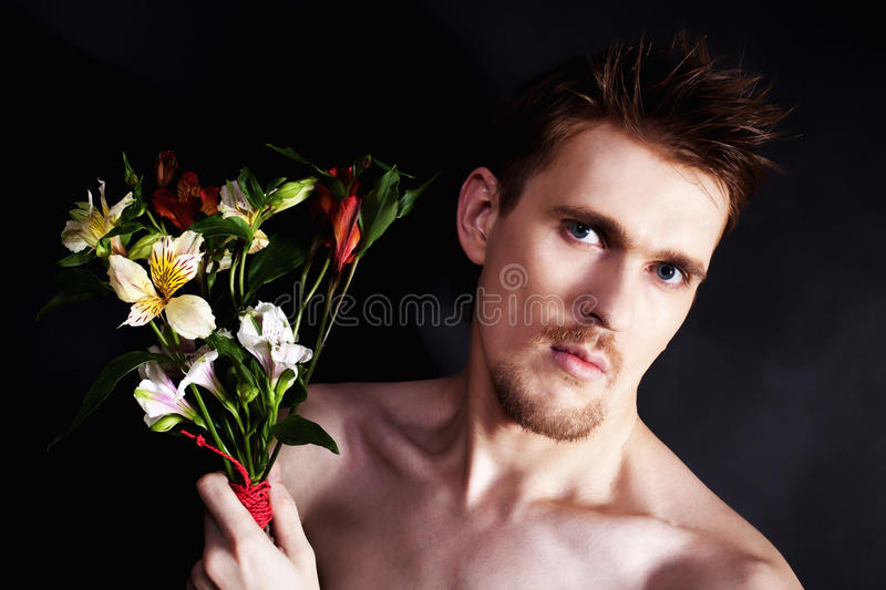Download Young Man Sniffing Bouquet Of Flowers Closeup Stock Image - Image of color, holding: 17923711