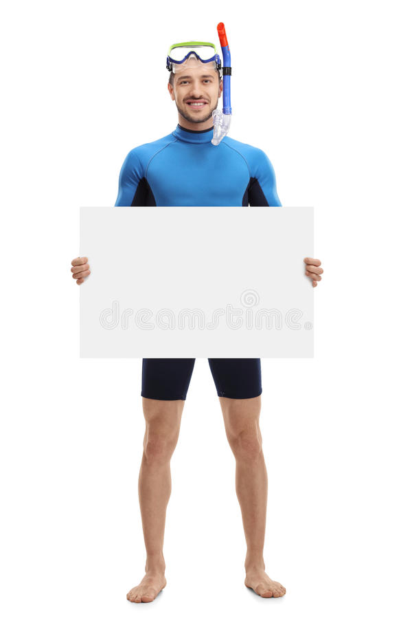 Young man with snorkeling equipment holding a blank signboard. Full length portrait of a young man with snorkeling equipment holding a blank signboard isolated royalty free stock photography
